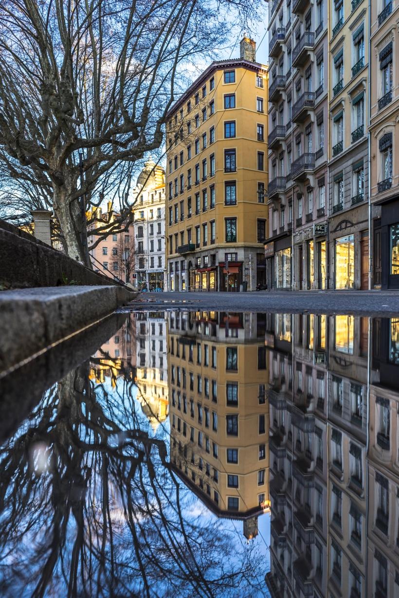 Lyon, France : puddle reflection on Quai Saint-Vincent roadside