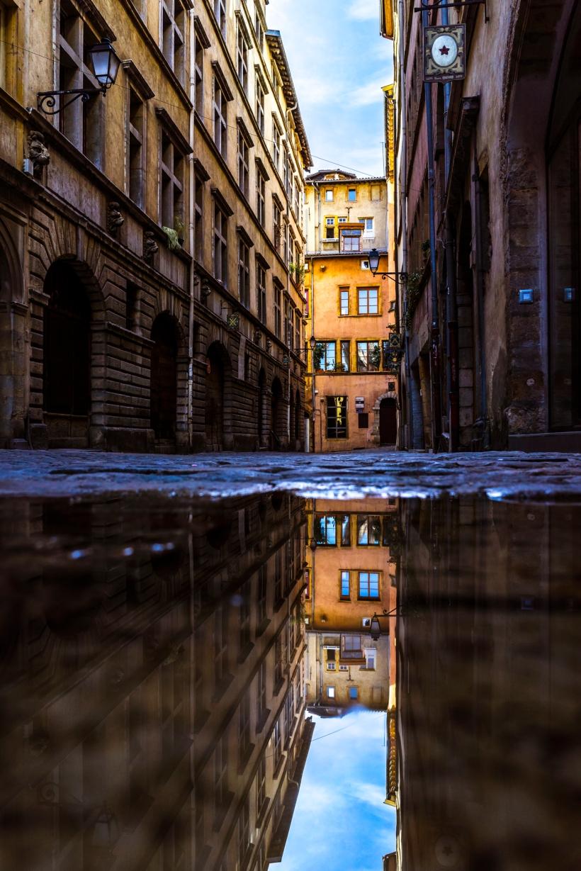 Lyon, France : puddle reflection in Rue Juiverie, Vieux Lyon