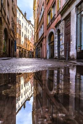 Lyon, France : Puddle reflection in Rue Sergent Blandan