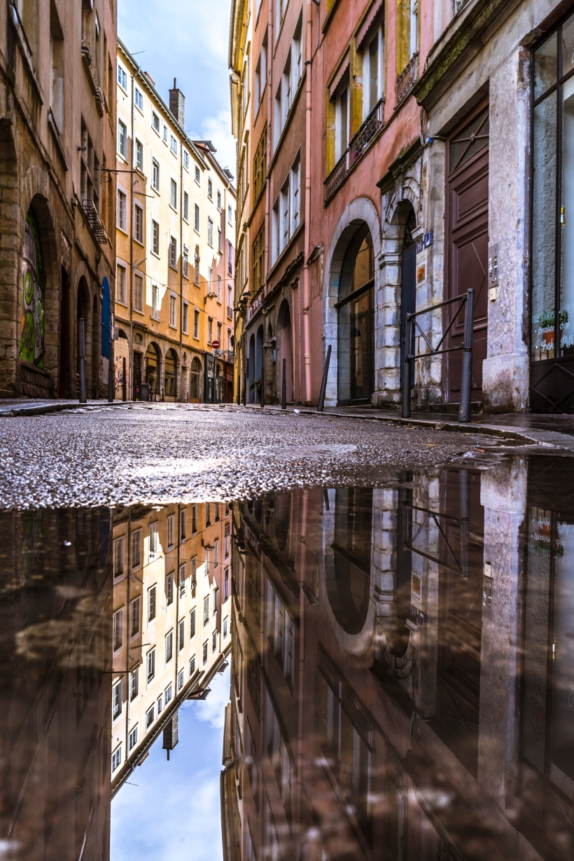 Lyon, France : Puddle reflection in Rue Sergent Blandan