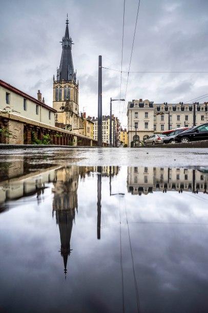Lyon, France - Saint-Paul reflection in a puddle