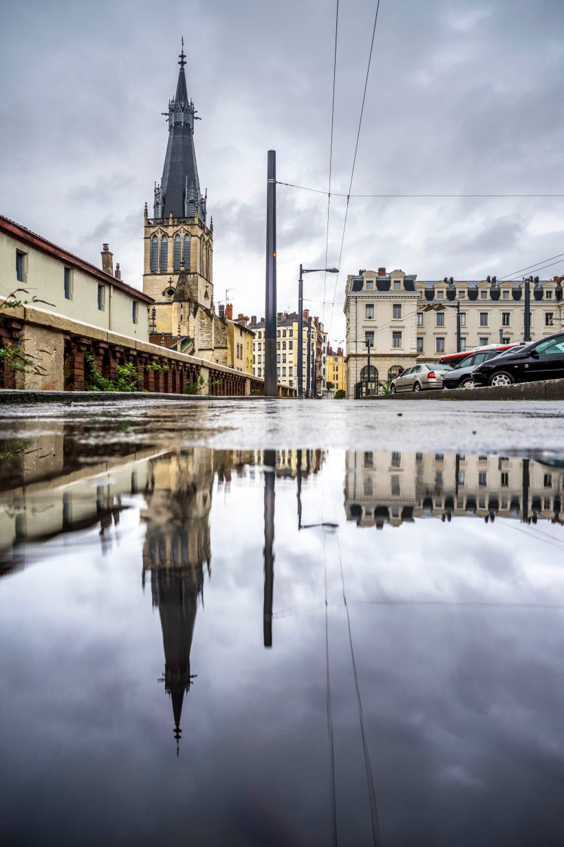 Lyon, France - Saint-Paul reflection in a puddle