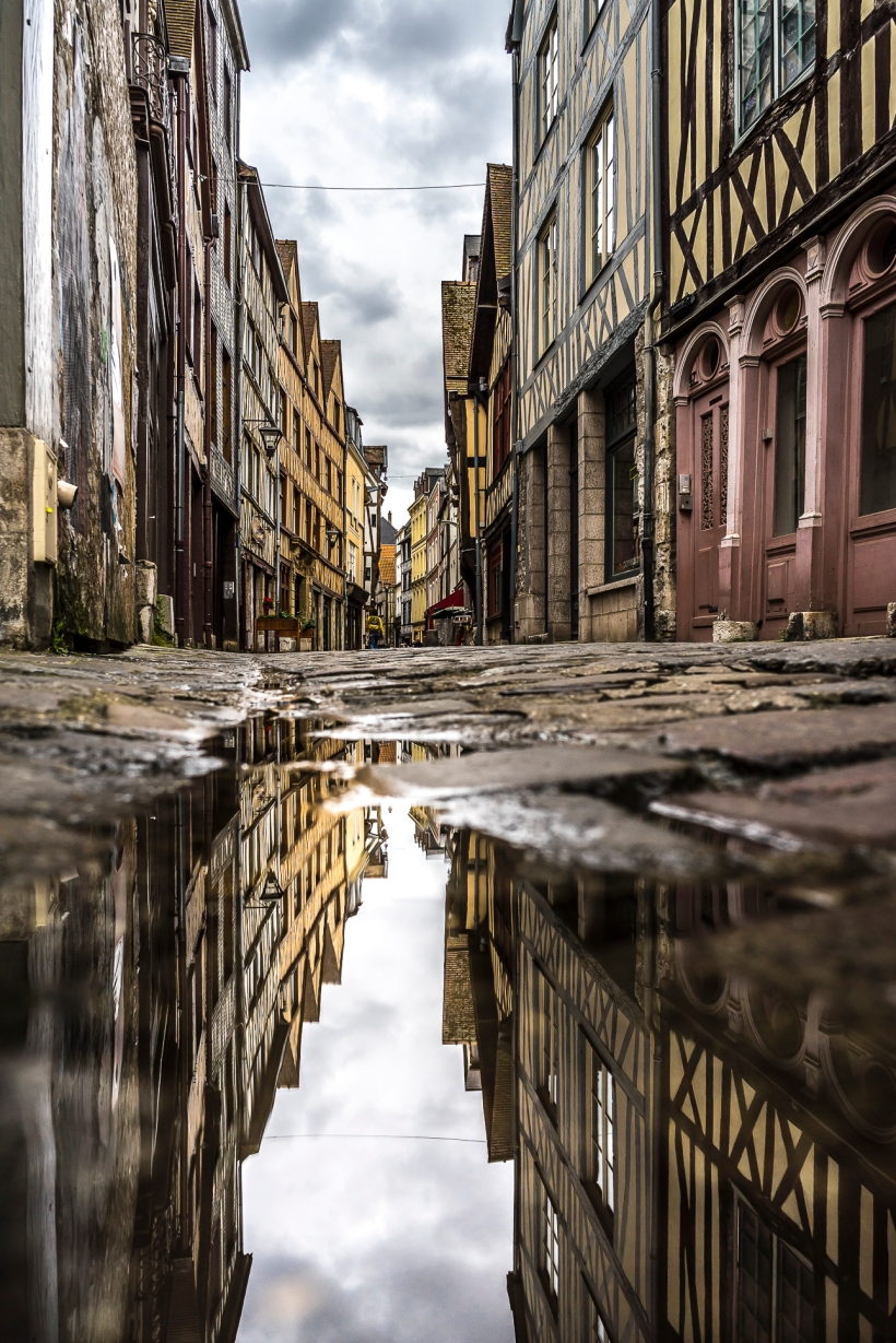 Rouen, half-timbered houses reflecting in a puddle