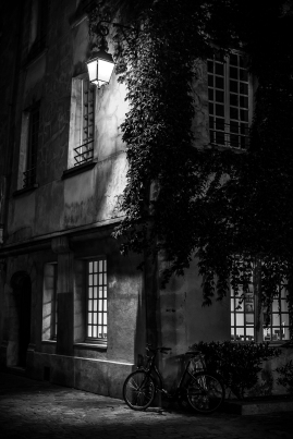 Paris, France - In the darkness of the night, at the corner of a street