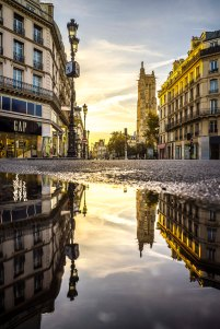 Paris, France - Sunrise on Tour Saint-Jacques, reflection in a puddle