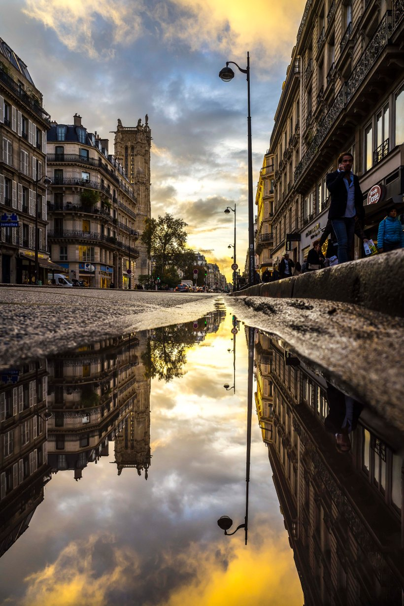 Paris, France - Tour Saint-Jacques in a puddle at sunset