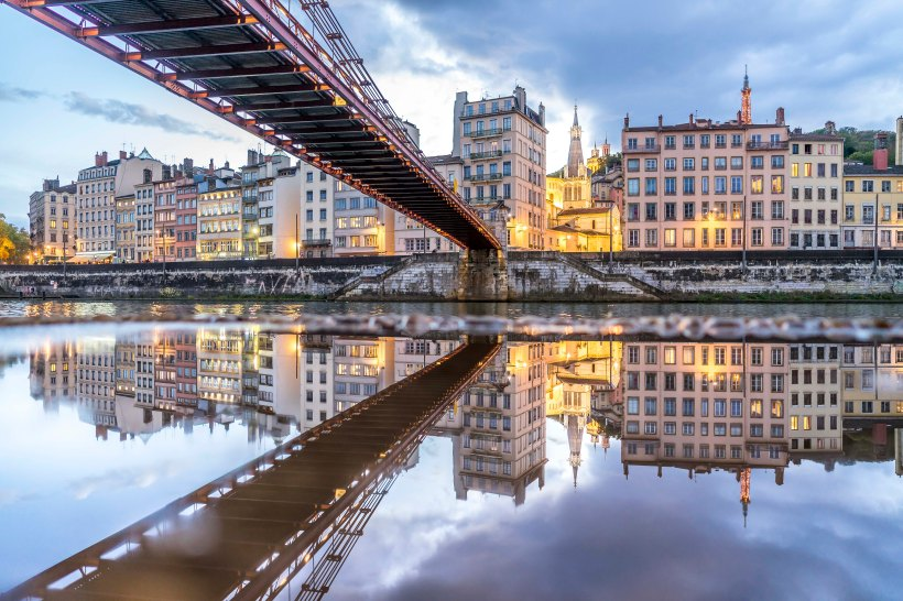 Lyon, France - Saint-Paul reflecting in a puddle at sunset