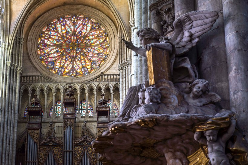 Amiens, France - Angel pointing at the rose in the Cathedral Notre-Dame d'Amiens
